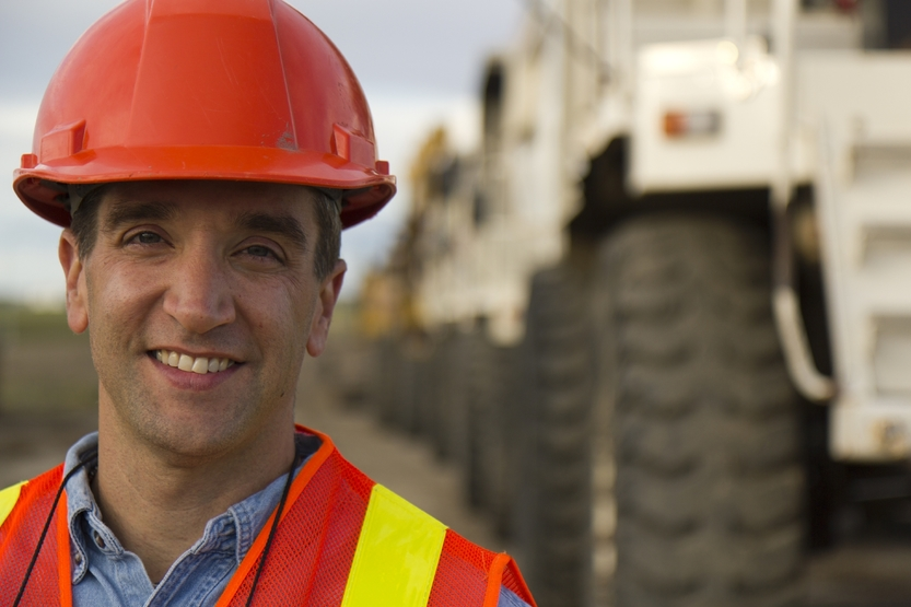 Construction worker smiles while on site