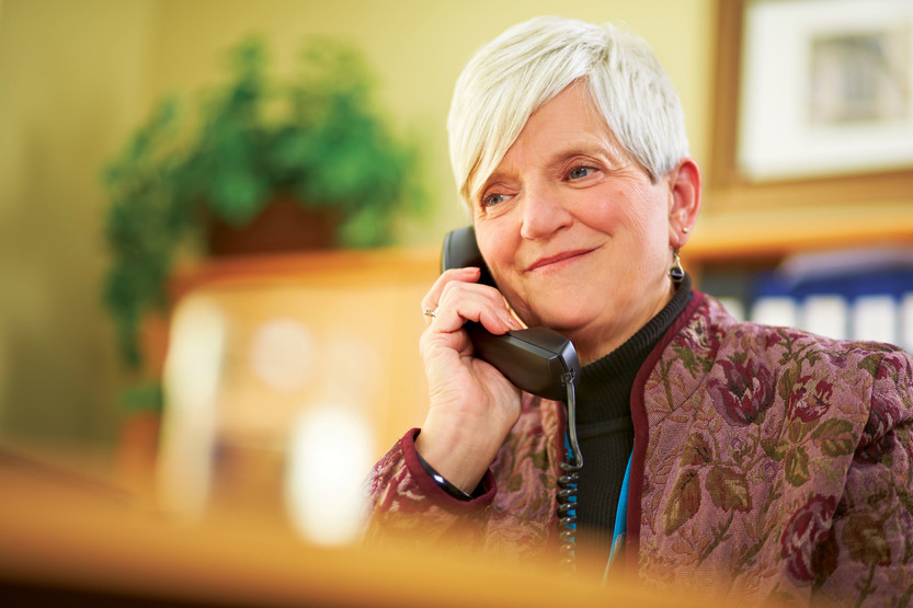 Woman answers phone