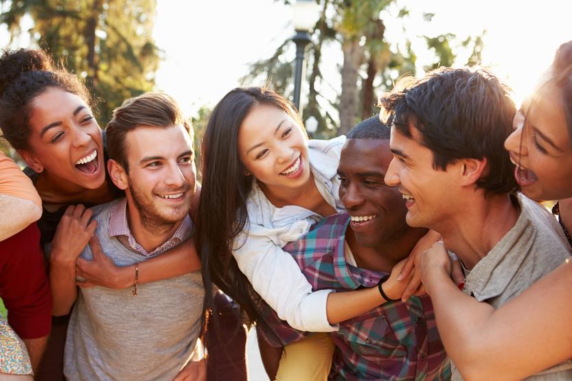 Young people hug and smile
