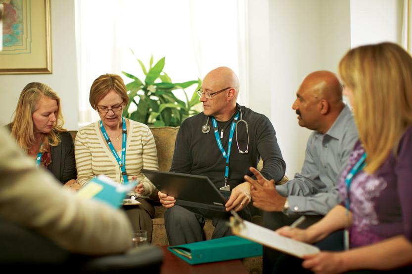 Treatment team members meet